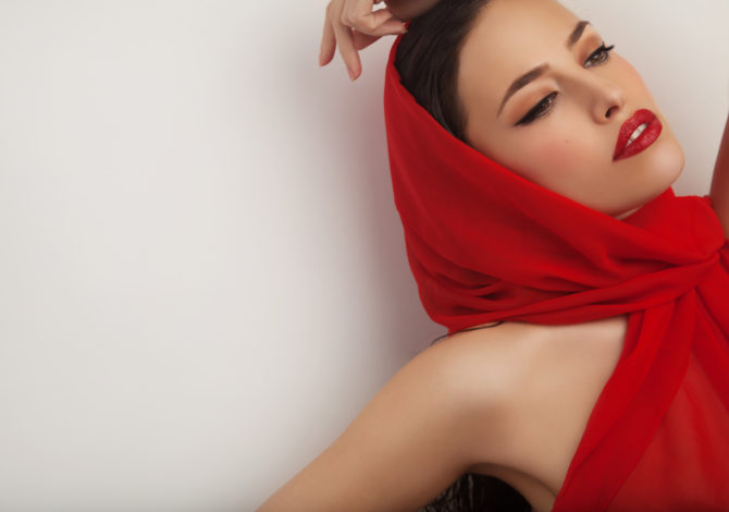 beautiful woman portrait with red lips and red veil over her head