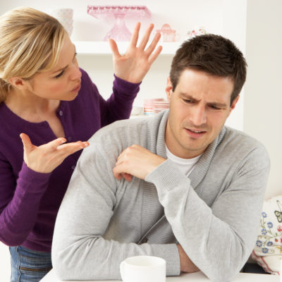 Young Couple Having Argument In Kitchen At Home