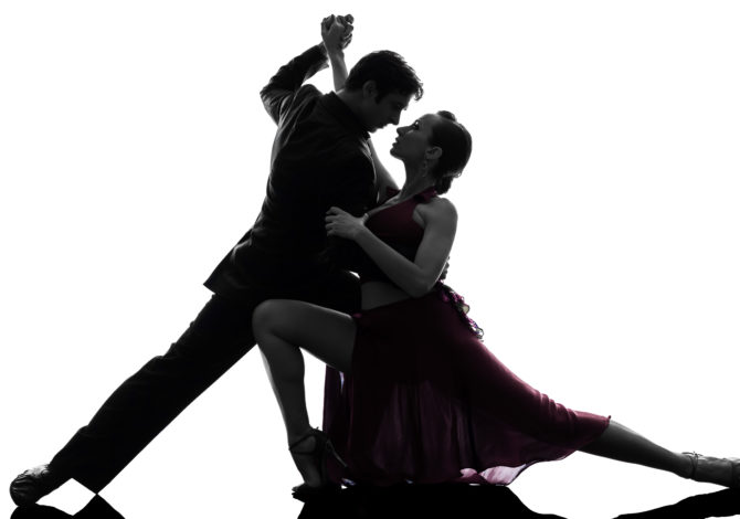 one caucasian couple man woman ballroom dancers tangoing  in silhouette studio on white background
